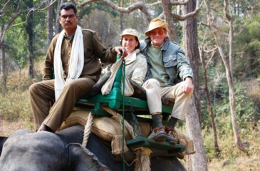 Jacky and Bill Keith on elephant back 